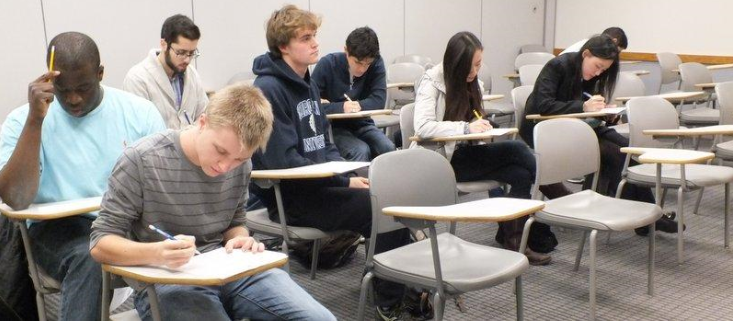 Students taking an exam.