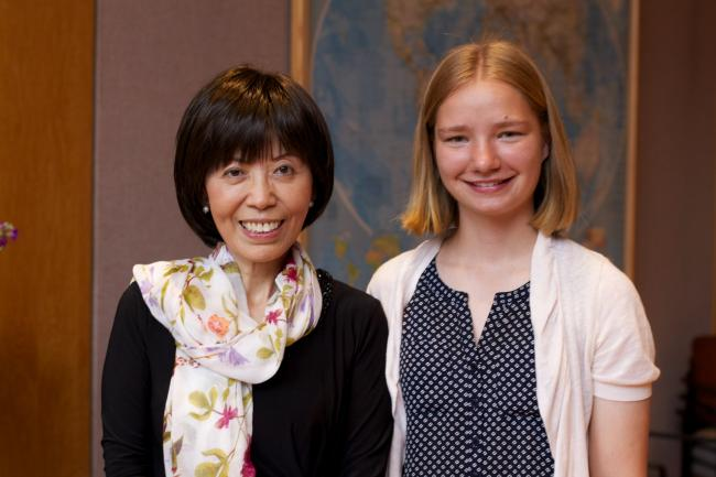Professor Yu with a student.